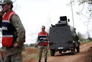 <p>Turkish military personnel on patrol near the border with Syria in Kilis. Turkey's prime minister has vowed to retaliate against Syria for its 'heinous' downing of one of its warplanes, as the head of NATO said such an attack on one of its members was unacceptable.</p>
