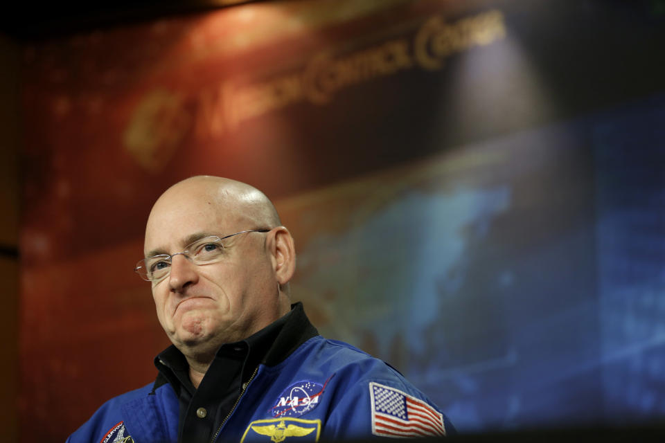 NASA astronaut Scott Kelley listens to a question about his scheduled mission aboard the International Space Station during a briefing Wednesday, Dec. 5, 2012, at Johnson Space Center in Houston. Kelly and Russian cosmonaut Mikhail Kornienko will spend an entire year aboard the International Space Station beginning in 2015. (AP Photo/David J. Phillip)