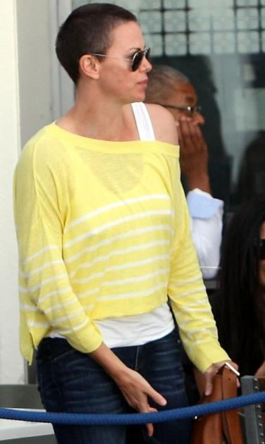Charlize Theron is spotted with her new shaved head in Cape Town, South Africa on November 16, 2012 -- Getty Premium