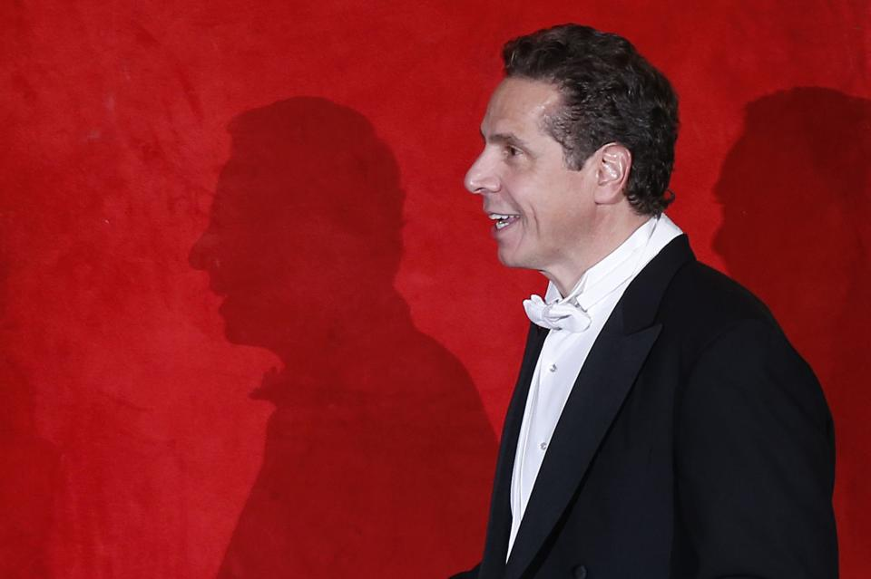 New York Governor Andrew Cuomo is introduced as he takes the dais during the Alfred E. Smith Memorial Foundation Dinner, a charity gala organized by the Archdiocese of New York, at the Waldorf-Astoria hotel, Thursday, Oct. 17, 2013, in New York. (AP Photo/Jason DeCrow)