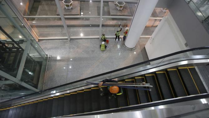 Workers put the final touches to the new terminal two wing at Noi Bai international airport in Hanoi