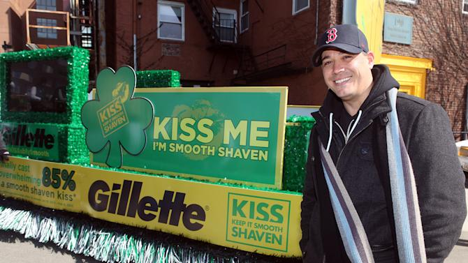 """IMAGE DISTRIBUTED FOR GILLETTE - Boston's own """"Boston Rob"""" Mariano declared """"Kiss Me, I'm Smooth Shaven!"""" onboard the Gillette float at the St. Patrick's Day Parade in Boston, reminding guys to K.I.S.S. - Keep It Smooth Shaven, on Sunday, March 17 2013. A recent study revealed that 85% of women prefer to kiss a man who's smooth shaven, and that two out of three women said men will have better luck with them if they are stubble-free. (Photo by Aynsley Floyd/Invision for Gillette/AP Images)"""