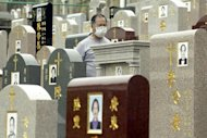 File photo shows a man walking through the Chinese Christian Cemetary in Hong Kong. Even death does not provide relief from soaring property prices in Hong Kong, where those seeking a final resting place for a loved one face high costs and a shortage of space