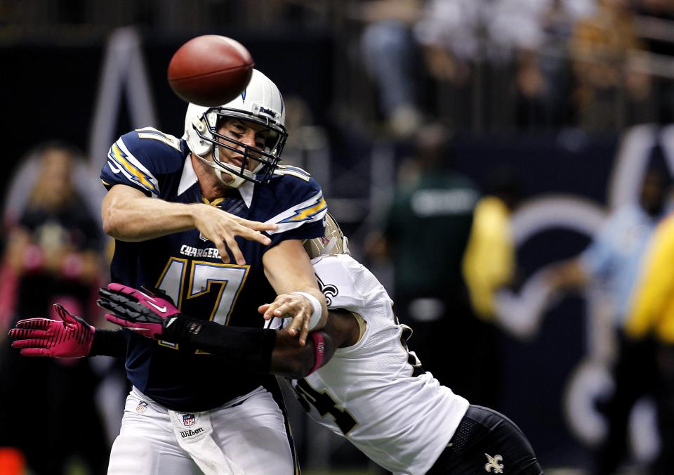 San Diego Chargers quarterback Philip Rivers (17) is hit by New Orleans Saints cornerback Corey White (24) as he tries to pass in the first half of an NFL football game at the Mercedes-Benz Superdome in New Orleans, Sunday, Oct. 7, 2012. (AP Photo/Gerald Herbert)