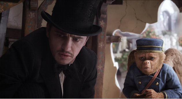 "This film image released by Disney Enterprises shows James Franco, as Oz, left, and the character Finley, voiced by Zach Braff, are shown in a scene from ""Oz the Great and Powerful."" (AP Photo/Disney"