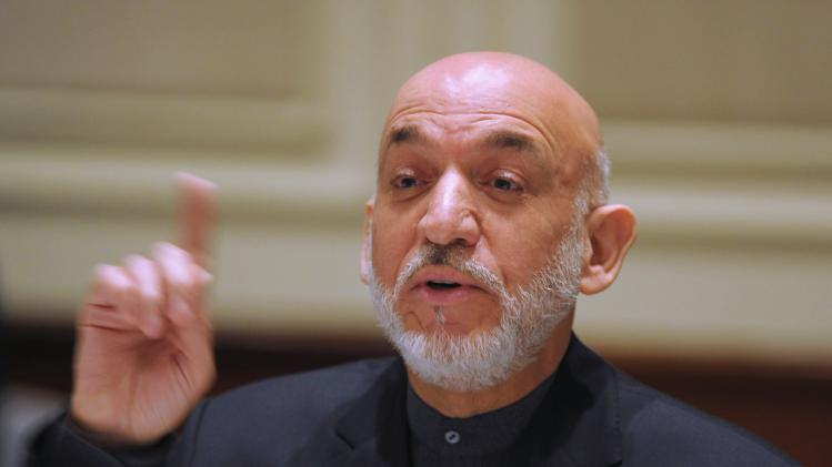 Afghanistan's President Karzai addresses media representatives during press interaction in New Delhi