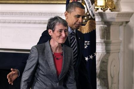 U.S. President Barack Obama leaves with Sally Jewell, CEO of Recreational Equipment Inc., his nominee for Interior Secretary, at the White House in Washington February 6, 2013. REUTERS/Yuri Gripas
