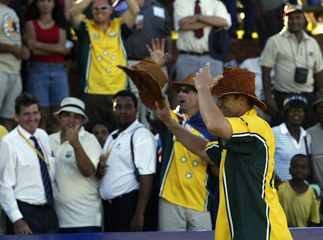 Matthew Hayden of Australia is given a hat by Australian fans