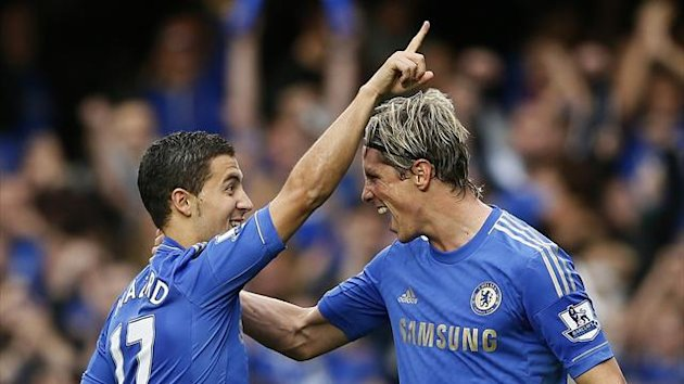 Chelsea's Eden Hazard (L) celebrates with teammate Fernando Torres after scoring against Newcastle United (Reuters)