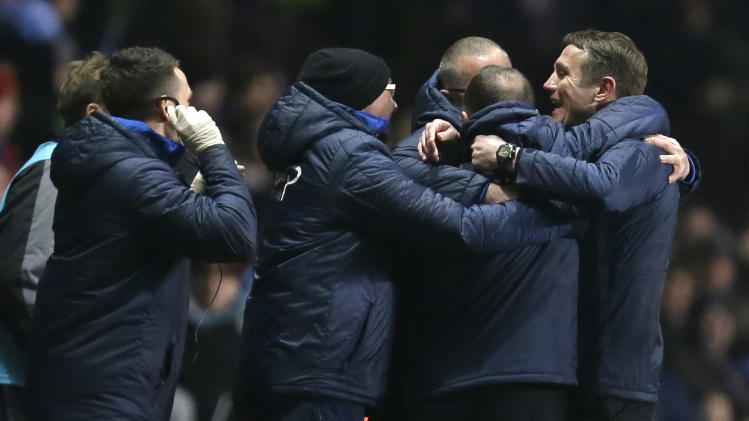 Bradford City' manager Phil Parkinson, right,  celebrates after defeating Aston Villa over the two legs of their English League Cup semi-final soccer match at Villa's stadium in Birmingham, England, Tuesday, Jan. 22, 2013. Villa won 2-1 on the night but lost 4-2 on an aggregate score. (AP Photo/Alastair Grant)