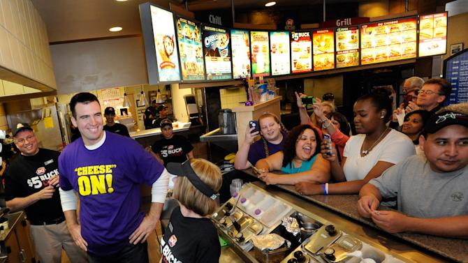 IMAGE DISTRIBUTED FOR DAIRY QUEEN - Baltimore Ravens quarterback, Super Bowl MVP and famous number five Joe Flacco, second from left, serves DQ $5 Buck Lunches at a Dairy Queen restaurant Friday, April 19, 2013 in Baltimore. Flacco visited DQ and presented a check for $25,000 to the Matthew J. Cheswick Memorial Fund, named for a Glenelg High School (Md.) student who was killed in May 2012 by a drunk driver. (Steve Ruark / AP Images for Dairy Queen)