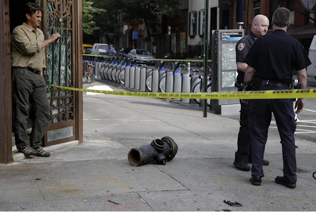 A fire hydrant broken sits on the sidewalk after  a car accident in the East Village section of New York, Wednesday, June 19, 2013. Fire authorities say eight people have been hurt, several of them se