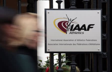 A woman walks past the International Association of Athletics Federations headquarters in Monaco