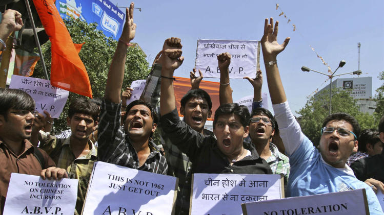 Indian supporters of Akhil Bharatiya Vidhyarthi Parishad (ABVP) or All India Student Council hold placards and shouts slogans against the alleged incursion by Chinese troops into Indian territory, during a protest in Ahmadabad, India, Wednesday, May 1, 2013.  India said around 50 Chinese troops crossed the de facto border between the countries and went 19 kilometers (12 miles) into Indian territory on April 15 and are camping in tents in Ladakh in the eastern part of Indian-administered Kashmir. (AP Photo/Ajit Solanki)