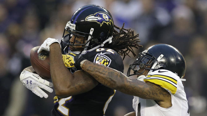 Pittsburgh Steelers cornerback Ike Taylor, right, breaks up a pass intended for Baltimore Ravens wide receiver Torrey Smith during the first half of an NFL football game in Baltimore, Sunday, Dec. 2, 2012. (AP Photo/Patrick Semansky)