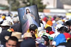 A crowd waits for Pope Francis to celebrate mass in…