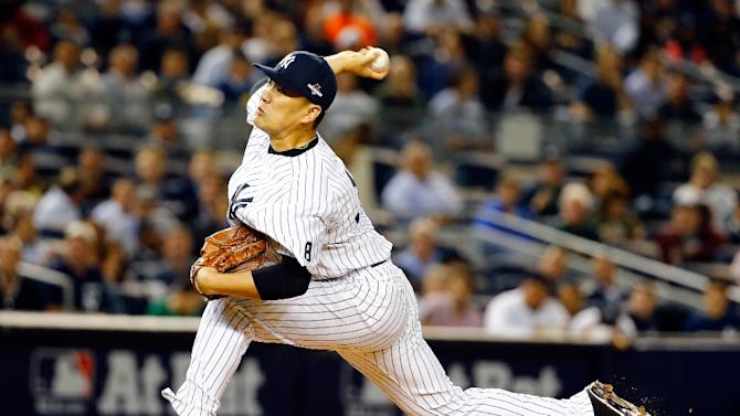 Masahiro Tanaka #19 of the New York Yankees throws a pitch in the first inning against the Houston Astros during the American League Wild Card Game at Yankee Stadium on October 6, 2015 in New York City