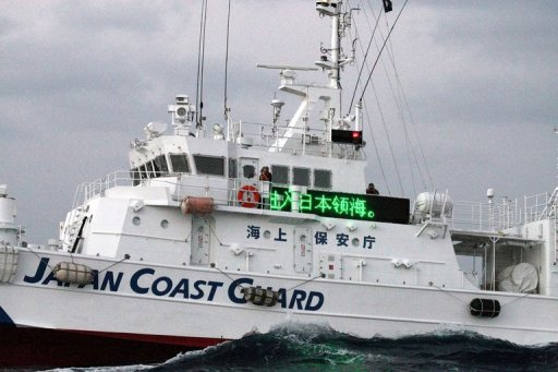 "<p>Image provided by Taiwan's CNA shows a Japan Coast Guard patrol boat displaying a sign reading ""Japanese territorial waters"" off the disputed islands in the East China Sea on September 25. China and Japan on Saturday marked the 40th anniversary of the resumption of diplomatic ties, but no major celebrations were likely.</p>"