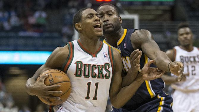 Milwaukee Bucks' Brandon Knight (11) drives against Indiana Pacers' Donald Sloan during the first half of an NBA basketball game on Wednesday, April 9, 2014, in Milwaukee