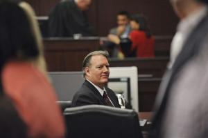 Dunn looks at his family during his murder trial in Jacksonville