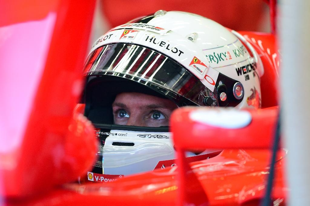 Ferrari's Vettel puts Pirelli row behind him, for now