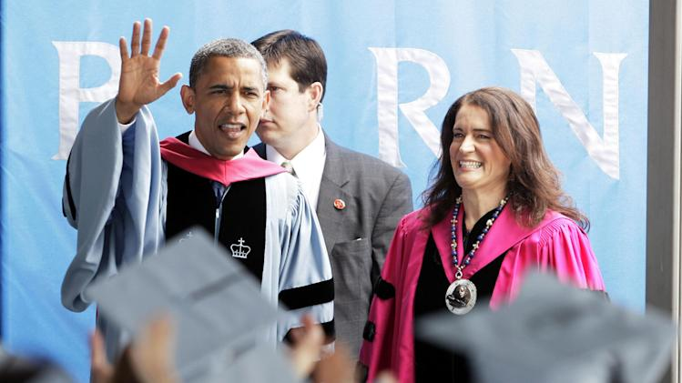 President Barack Obama arrives to deliver the commencement address to graduates at all-female Barnard College, on the campus of Columbia University, accompanied by Barnard President Debora L. Spar, in New York,  Monday, May 14, 2012. Barnard was the first college in New York City where women could receive the same liberal arts education available to men. (AP Photo/Richard Drew)