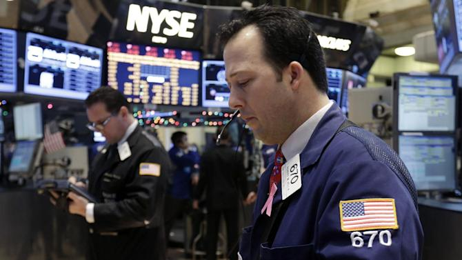 """In this Friday, Dec. 14, 2012, photo, trader Robert Vella, right, works on the floor of the New York Stock Exchange. Stocks edged higher on Wall Street amid optimism that the lawmakers in Washington are closing in on a budget deal that will stop the U.S. going over the """"fiscal cliff.""""  (AP Photo/Richard Drew)"""