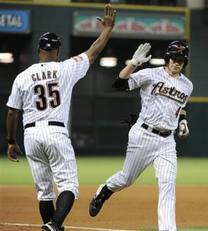 Lowrie, Happ lead Astros past Brewers 4-0