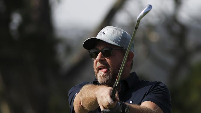 Gregg Ontiveros hits his tee shot on the fifth hole during the first round of the Pebble Beach Pro-Am golf tournament
