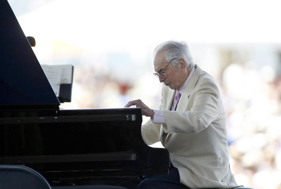 FILE - In this Aug. 8, 2010 file photo, Dave Brubeck plays at the CareFusion Newport Jazz Festival in Newport, R.I.  Brubeck is among the featured artists scheduled to return to the festival on Sunday, Aug. 7, 2011. (AP Photo/Joe Giblin, File)
