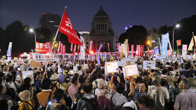 Anti-nuclear protesters stage a rally outside Japan's parliament complex in Tokyo, Sunday, July 29, 2012. Thousands of the protesters rallied to demand the government abandon nuclear power after the accident last year in northern Fukushima.  (AP Photo/Itsuo Inouye)