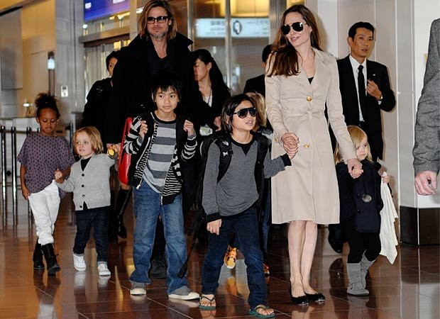 The Jolie-Pitts arrive in Tokyo. Splash News