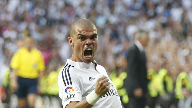 """Real Madrid's Pepe celebrates after scoring against Barcelona during their Spanish first division """"Clasico"""" soccer match at the Santiago Bernabeu stadium in Madrid"""