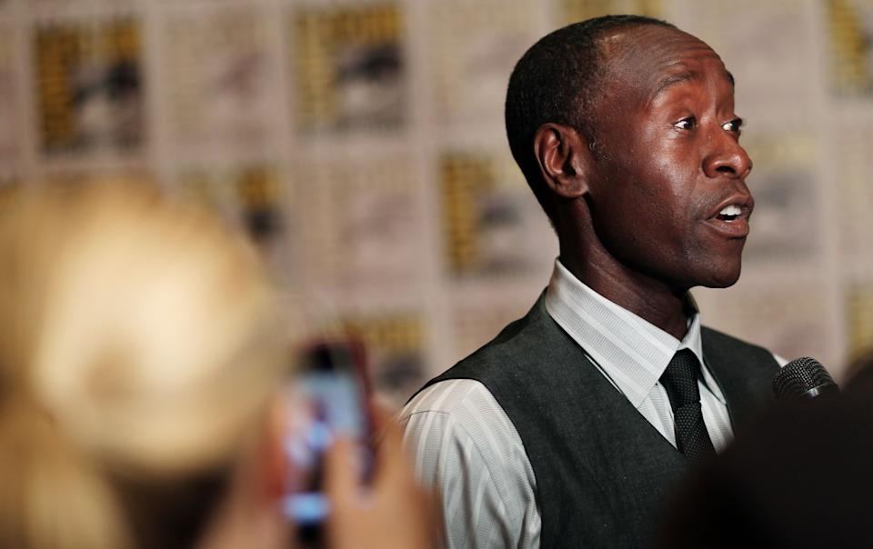 "Don Cheadle attends the press line for ""Iron Man 3"" during Comic-Con, Saturday, July 14, 2012, in San Diego. (Photo by Matt Sayles/Invision/AP)"