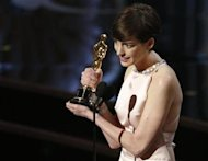 Anne Hathaway accepts the award for best supporting actress for her role in &quot;Les Miserables&quot; at the 85th Academy Awards in Hollywood, California February 24, 2013. REUTERS/Mario Anzuoni