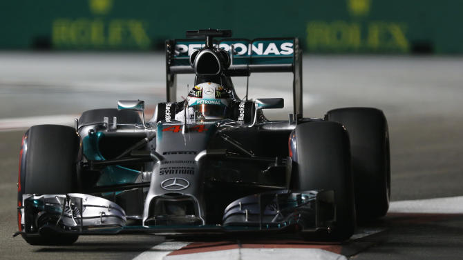 Mercedes driver Lewis Hamilton of Britain steers his car during the qualifying session for the Singapore Grand Prix on the Marina Bay City Circuit in Singapore, Saturday, Sept. 20, 2014. (AP Photo/Ng Han Guan)