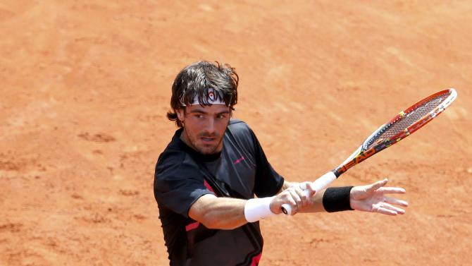 Gastao Elias of Portugal plays a shot to Benoit Paire of France during their men's singles match at the French Open tennis tournament at the Roland Garros stadium in Paris