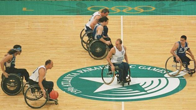 16 Aug 1996: Great Britian (white) moves the ball down the court during a 93-36 victory over Argentina at the 1996 Paralympic Games in Atlanta