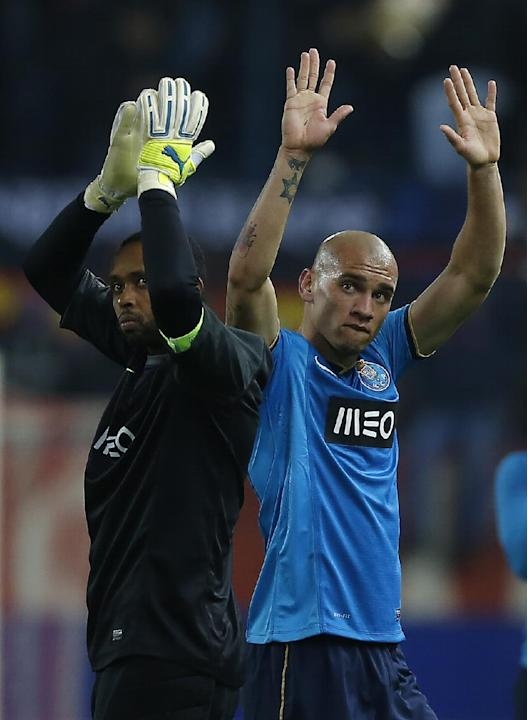 Porto's Maicon, right, and Porto's goalkeeper Helton, left, gesture,  during a Champions League Group G soccer match between Atletico Madrid and FC Porto, at the Vicente Calderon stadium in Ma