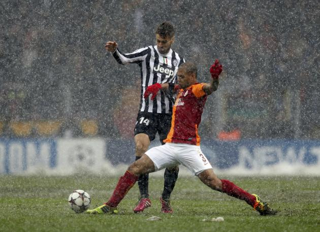 Melo of Galatasaray challenges Llorente of Juventus during their Champions League soccer match in Istanbul