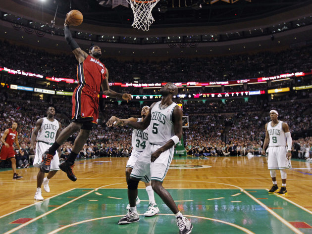 Miami Heat forward LeBron James (6) elevates for a dunk past Boston Celtics' Brandon Bass (30), Paul Pierce (34), Kevin Garnett (5) and Rajon Rondo (9) during the first half in Game 6 of the NBA baske