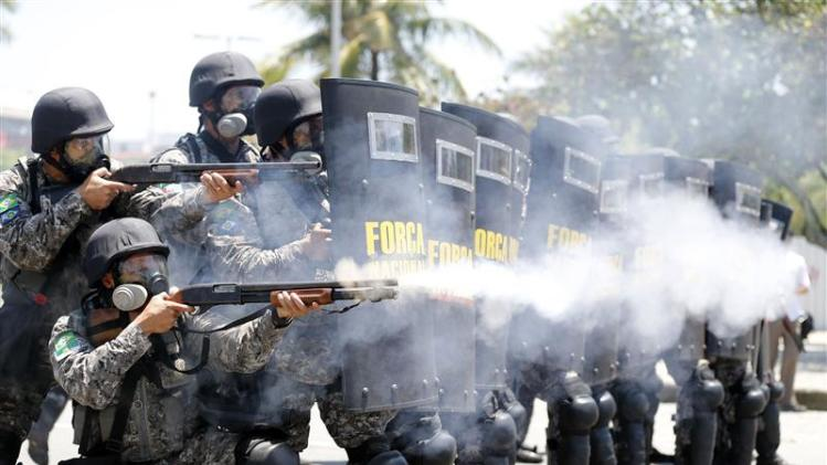 National Force soldiers fire rubber bullets during clashes with demonstrators near Hotel Windsor, where the auction for Libra offshore oilfield will take place, in Rio de Janeiro