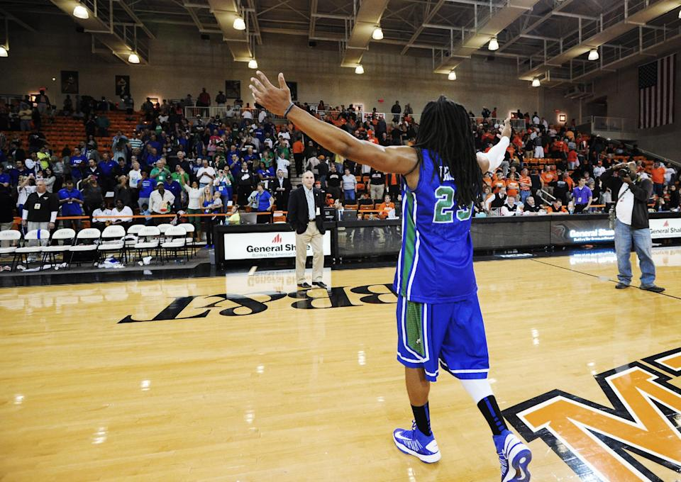 Florida Gulf Coast's Sherwood Brown (25) celebrates in front of the fans in the stands after his team defeated Mercer in an NCAA college basketball game for the Atlantic Sun men's tournament championship, in Macon, Ga., Saturday, March 9, 2013. Florida Gulf Coast won 88-75. (AP Photo/Woody Marshall)