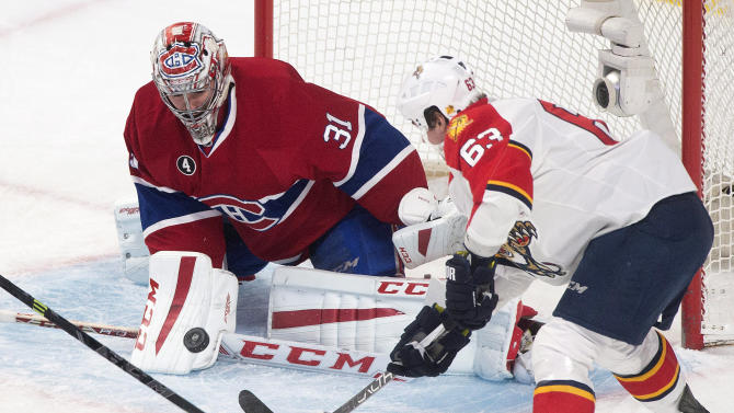 Montreal Canadiens goaltender Carey Price(31) makes a save on Florida Panthers' Dave Bolland during first period NHL hockey action in Montreal, Saturday, March 28, 2015.  (AP Photo/The Canadian Press,Graham Hughes)