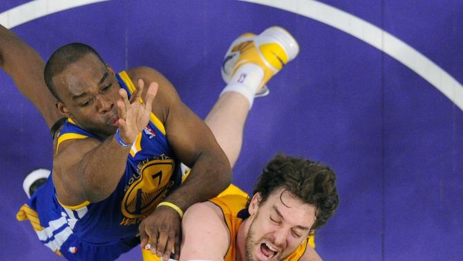 Los Angeles Lakers forward Pau Gasol, center, of Spain, puts up a shot as Golden State Warriors guard Jarrett Jack, below, and forward Carl Landry defend during the first half of their NBA basketball game, Friday, April 12, 2013, in Los Angeles. (AP Photo/Mark J. Terrill)