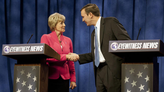 FILE - In this Oct. 7, 2012, file photo U.S. Senate candidates for Connecticut, Republican Linda McMahon and Democratic Rep. Chris Murphy, D-Conn., shake hands after a live televised debate in Rocky Hill, Conn.  In the lineup of ticket-splitting races to watch, the race between McMahon an Murphy is one of the biggest surprises and promising opportunities for the GOP in the closing weeks of the campaign. Former professional wrestling executive McMahon, in her second Senate bid, is running even with three-term Murphy in the Democratic-leaning state.  (AP Photo/Jessica Hill, File)