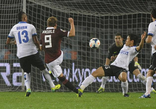 Torino's Ciro Immobile shoots to score against Inter Milan during their Italian Serie A soccer match at the Olympic stadium in Turin