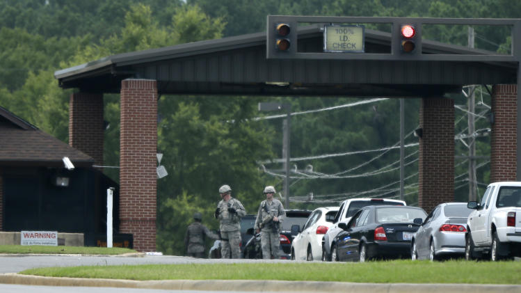 U.S. air Force security personell patrol near stopped traffic entering the front gate at Little Rock Air Force Base in Jacksonville, Ark., Wednesday, July 23, 2014. The base was put on lockdown late Wednesday morning. (AP Photo/Danny Johnston)