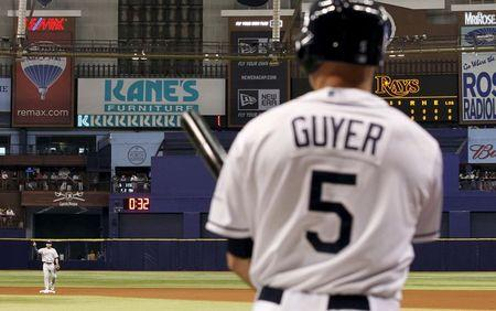 File photo of Rays' Guyer on deck to bat as the MLB timing clock counts down between innings against the Blue Jays at Tropicana Field in St. Petersburg