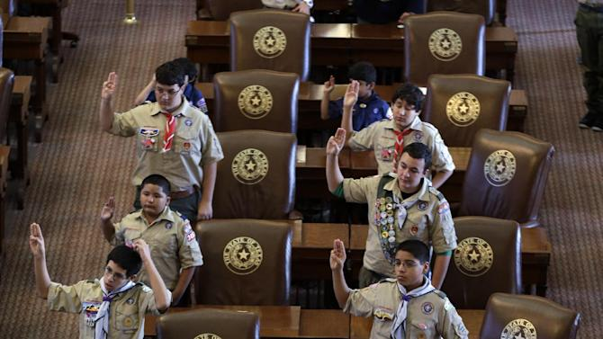 FILE - In this Feb. 2, 2013 file photo, Boy Scouts recite the Scout Oath during the annual Boy Scouts Parade and Report to State in the House Chambers at the Texas capitol, in Austin, Texas. President Barack Obama said Sunday, Feb. 3, 2013 that gays should be allowed in the Boy Scouts and women should be allowed in military combat roles. (AP Photo/Eric Gay, File)